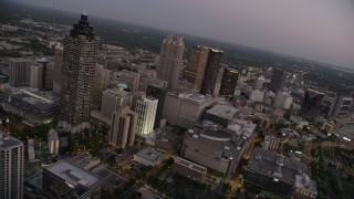 AX40_014 - 5K stock footage aerial video flying by skyscrapers and office buildings, Downtown Atlanta, sunset