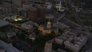 AX40_015 - 5K stock footage aerial video orbiting Georgia State Capitol, Downtown Atlanta, sunset