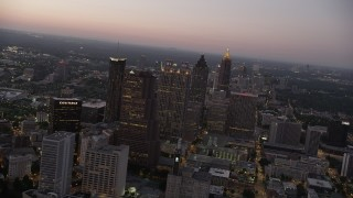AX40_017 - 5K stock footage aerial video flying by skyscrapers, Downtown Atlanta, Georgia, sunset