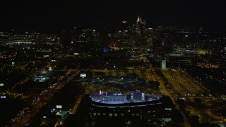 AX41_005E - 5K stock footage aerial video approach and bird's eye of Turner Field, tilt to reveal Downtown Atlanta skyline, Atlanta, Georgia, night
