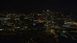 AX41_006 - 5K stock footage aerial video tilting up to reveal Downtown Atlanta skyline, Atlanta, Georgia, night