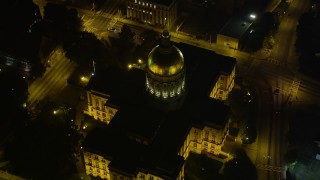 AX41_007 - 5K stock footage aerial video approaching and tilting down on Georgia State Capitol, Downtown Atlanta, night