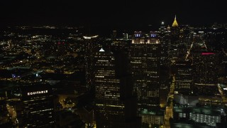 AX41_008 - 5K stock footage aerial video flying by skyscrapers in Downtown Atlanta, Georgia, night