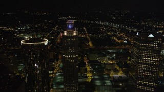 AX41_011 - 5K stock footage aerial video orbiting Tops of skyscrapers, Downtown Atlanta, Georgia, night