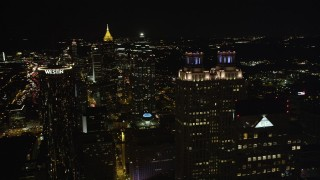 AX41_012 - 5K stock footage aerial video flying by tops of skyscrapers, Downtown Atlanta, Georgia, night