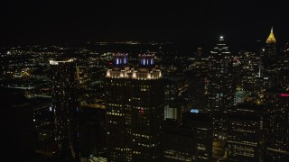 AX41_013 - 5K stock footage aerial video flying by 191 Peachtree Tower toward SunTrust Plaza, Downtown Atlanta, Georgia, night