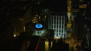 AX41_014 - 5K stock footage aerial video orbiting Hyatt Regency, Downtown Atlanta, Georgia, night