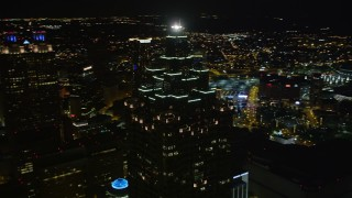 AX41_015 - 5K stock footage aerial video orbiting SunTrust Plaza, Downtown Atlanta, Georgia, night