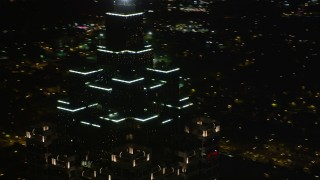 AX41_016 - 5K stock footage aerial video orbiting top of SunTrust Plaza, Downtown Atlanta, Georgia, night