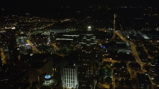 AX41_018 - 5K stock footage aerial video orbiting SunTrust Plaza revealing skyscrapers, Downtown Atlanta, Georgia, night