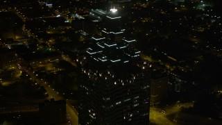 AX41_019E - 5K stock footage aerial video orbiting SunTrust Plaza, Downtown Atlanta, Georgia, night