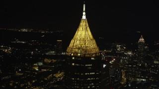 AX41_022 - 5K stock footage aerial video orbiting top of Bank of America Plaza, Midtown Atlanta, Georgia, night