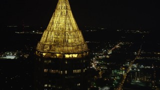 AX41_023 - 5K stock footage aerial video orbiting top of Bank of America Plaza, Midtown Atlanta, Georgia, night
