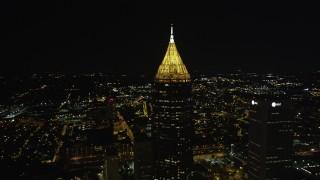 AX41_025 - 5K stock footage aerial video orbiting Bank of America Plaza revealing skyscrapers, Midtown Atlanta, night