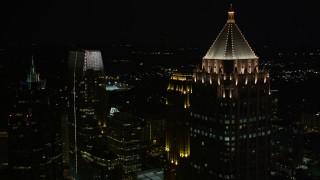 AX41_028E - 5K stock footage aerial video flyby and orbit skyscrapers around One Atlantic Center, Midtown Atlanta, Georgia, night