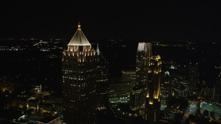AX41_029 - 5K stock footage aerial video flying by One Atlantic Center revealing skyscrapers, Midtown Atlanta, night
