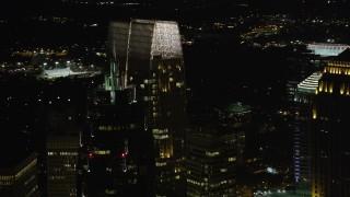 AX41_035 - 5K stock footage aerial video of a medium shot orbiting 1180 Peachtree, Midtown Atlanta, Georgia, night