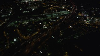 AX41_037 - 5K stock footage aerial video flying over heavy traffic on an expressway, Buckhead, Georgia, night