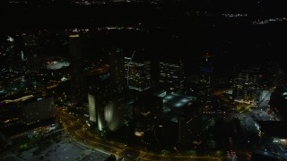 AX41_044 - 5K stock footage aerial video flying by skyscrapers, Buckhead, Georgia, night