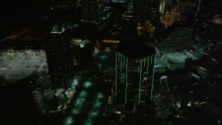 AX41_047 - 5K stock footage aerial video orbiting 3340 Peachtree Road, Buckhead, Georgia, night