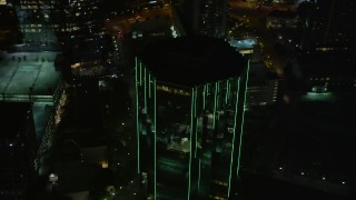 AX41_048 - 5K stock footage aerial video flying away from 3340 Peachtree Road, Buckhead, Georgia, night