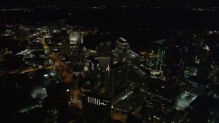 AX41_050 - 5K stock footage aerial video flying by skyscrapers toward Terminus Atlanta, Buckhead, Georgia