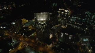 AX41_051 - 5K stock footage aerial video orbiting Terminus Atlanta revealing skyscrapers, Buckhead, Georgia, night