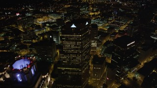 AX41_060 - 5K stock footage aerial video flying between skyscrapers revealing State Capitol, Downtown Atlanta, Georgia, night