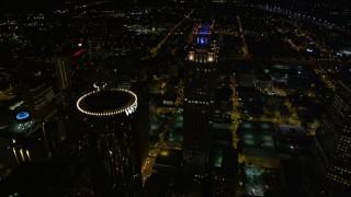 AX41_065E - 5K stock footage aerial video approaching skyscrapers, tilt to bird's eye of 191 Peachtree, Downtown Atlanta, Georgia, night
