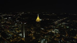 AX41_068 - 5K stock footage aerial video tilting down from black sky to Bank of America Plaza, Midtown Atlanta, night