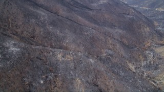 AX42_002 - 5K stock footage aerial video fly over scorched slopes of the Santa Monica Mountains, California