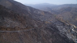 AX42_004 - 5K stock footage aerial video fly over the wildfire damaged slopes of Santa Monica Mountains, California