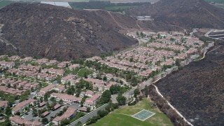 AX42_021 - 5K stock footage aerial video approach condominiums and duplex homes at the base of hills, Camarillo, California