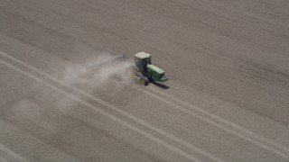 AX42_036 - 5K stock footage aerial video of tracking a tractor as it tills a field, Camarillo, California