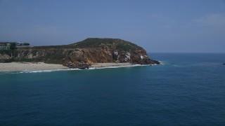 AX42_087 - 5K stock footage aerial video orbit the rugged cliffs of Point Dume, Malibu, California