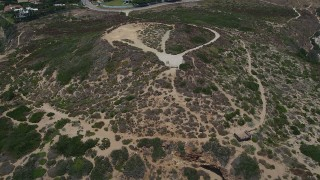 AX42_092 - 5K stock footage aerial video tilt from the Pacific Ocean to reveal and approach Point Dume, Malibu, California