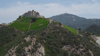 AX42_107 - 5K stock footage aerial video approach the scenic Rocky Oaks Estate Vineyards, Malibu, California