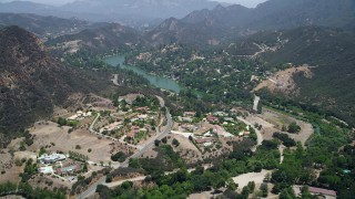 AX42_112 - 5K stock footage aerial video fly over spacious upscale homes to approach Malibu Lake, Agoura Hills, California
