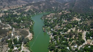 AX42_113 - 5K stock footage aerial video fly over Malibu Lake and lakefront homes homes, Agoura Hills, California
