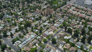 AX42_119 - 5K stock footage aerial video of a reverse view of suburban residential neighborhoods, West Hills, California