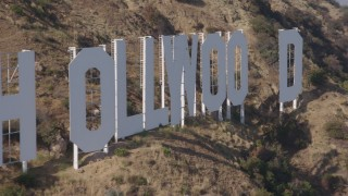 AX43_002 - 4K stock footage aerial video of a slow, close flyby of the Hollywood Sign, Los Angeles, California