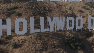 AX43_003 - 4K stock footage aerial video passing the famous Hollywood Sign, Los Angeles, California