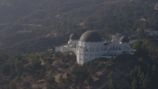 AX43_012 - 4K stock footage aerial video orbiting around the Griffith Observatory, Los Angeles, California
