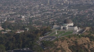 AX43_014 - 4K stock footage aerial video flying by the Griffith Observatory overlooking the city of Los Angeles, California