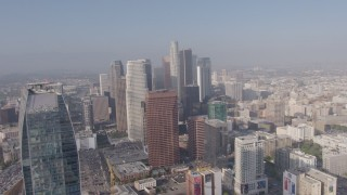 AX43_035 - 4K stock footage aerial video flying by Ritz-Carlton to approach skyscrapers in Downtown Los Angeles, California