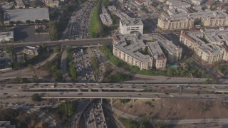 AX43_042 - 4K stock footage aerial video of bird's eye of traffic on the I-110 / 101 interchange, panning to apartment buildings, Downtown Los Angeles, California