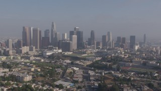 AX43_044 - 4K stock footage aerial video approaching the towering skyline of Downtown Los Angeles, California from Westlake