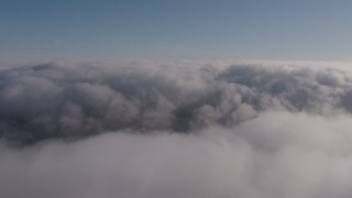 AX43_049 - 4K stock footage aerial video flying above a thick marine layer over Los Angeles, California