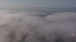 AX43_058 - 4K stock footage aerial video flying over marine layer clouds over Beverly Hills, California