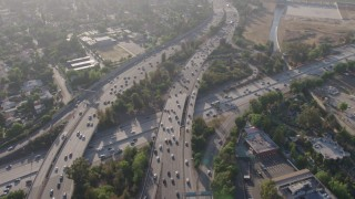 AX43_064 - 4K stock footage aerial video flying by heavy traffic on the I-405 / 101 interchange, Sherman Oaks, California